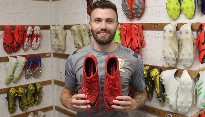 Signed boots for auction: Stuart Dallas