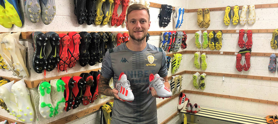 Signed boots for auction: Liam Cooper