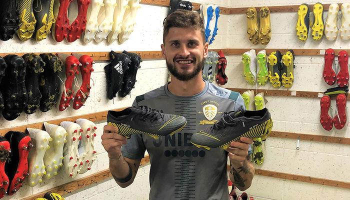 Signed boots for auction: Mateusz Klich