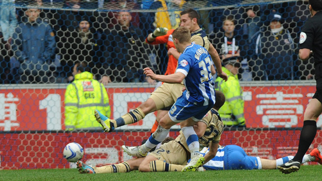 UNITED EDGED OUT AT WIGAN