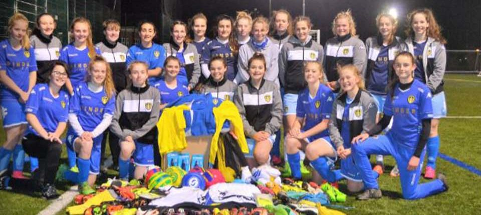 WHITES LADIES DONATE CLOTHING TO UGANDAN ORPHANAGE